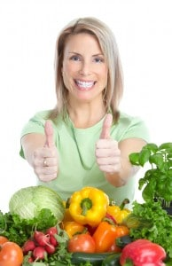 happy-woman-eating-vegetables-lakeway-cosmetic
